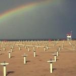 Rimini spiaggia con arcobaleno